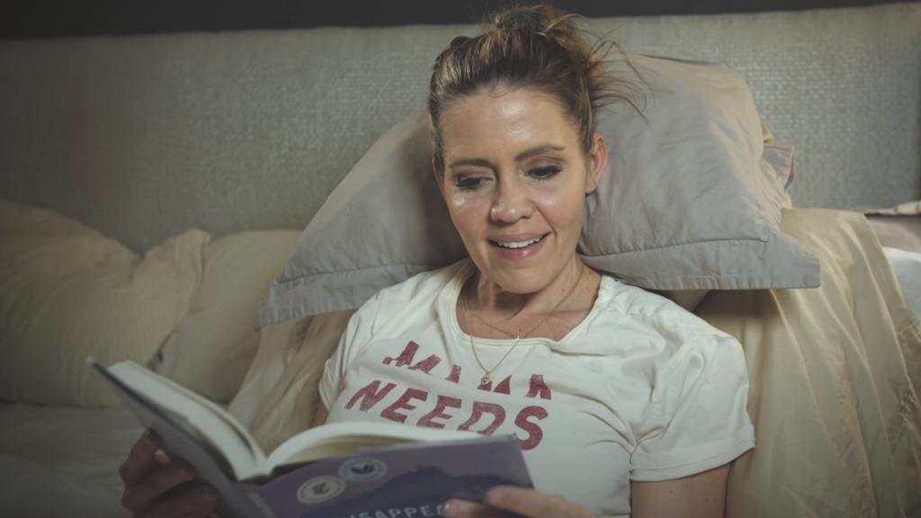 Kim reading a book